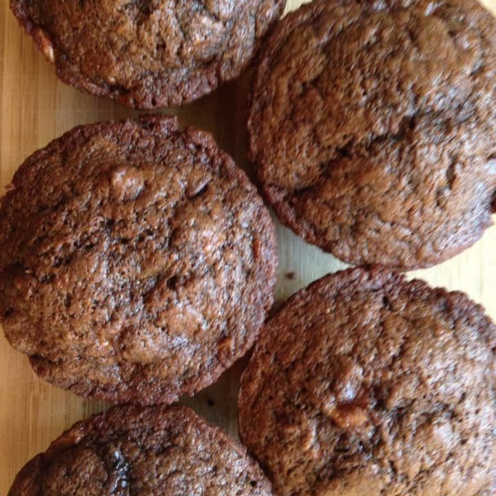 Overhead shot of 5 double chocolate muffins in two rows.