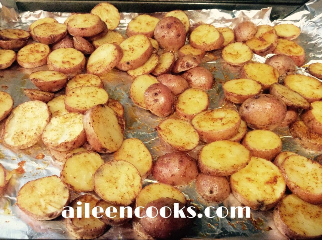 A cookie sheet filled with the roasted red potatoes recipe.