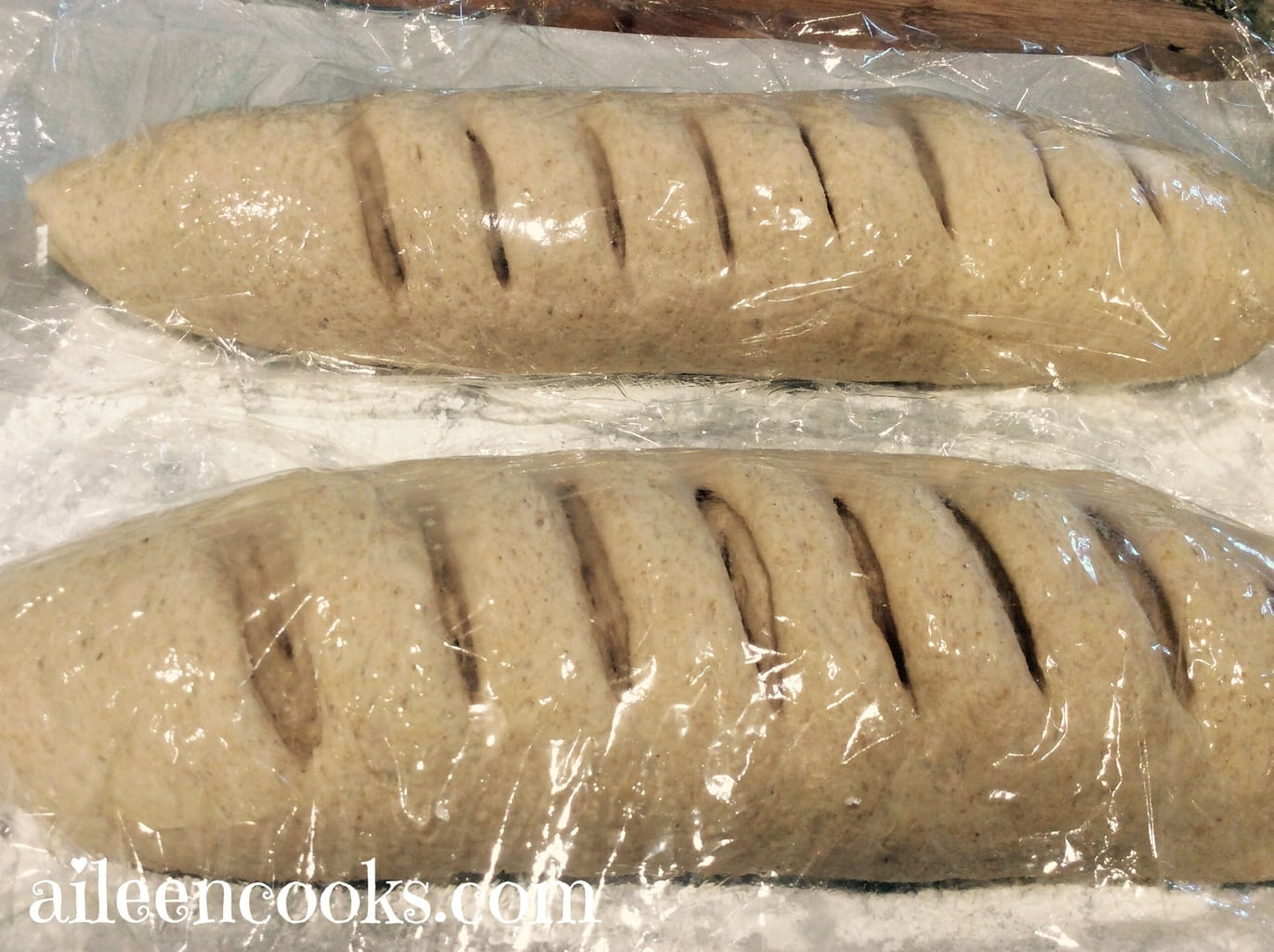 Two loaves of whole wheat french bread ready to be baked.