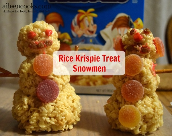 Fun and festive rice krispie treat snowmen made with rice krispies, cocoa krispies, and holiday rice krispies. Such a fun christmas tradition! Cooking With Kids Recipe from aileencooks.com #TidingsAndTreats #ad