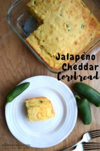 Glass baking dish of jalapeño cheddar cornbread above a white plate with a slice of cornbread.
