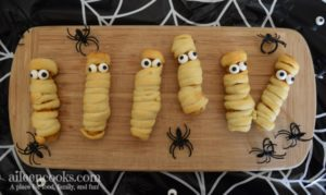 Halloween Mummy Chicken Fries. A fun twist on mummy dogs using crescent rolls and chicken fries.