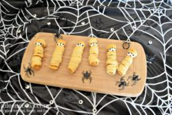 Halloween Mummy Chicken Fries. A fun twist on mummy dogs using crescent rolls and chicken fries.