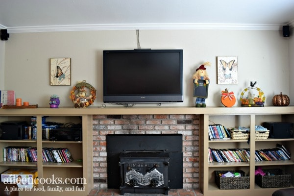How we decorated our mantel for fall - scarecrows, pumpkins, and day of the dead.