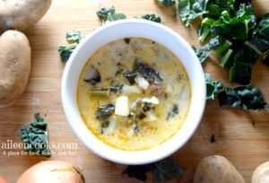 Make this delicious and hearty instant pot zuppa toscana soup at home! This recipe makes a large batch that tastes wonderful the next day. It's filled with hot Italian sausage, kale, hearty potatoes, garlic, and onion.