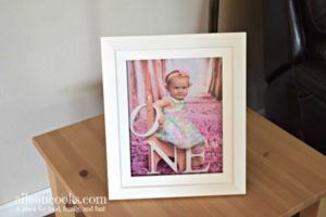 White picture frame with picture of little girl.