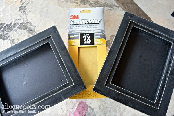 Learn how to spray paint black picture frames white with this easy to follow tutorial!