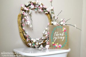think spring sign and spring wreath