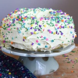 instant pot cake decorated with frosting and funfetti sprinkles.