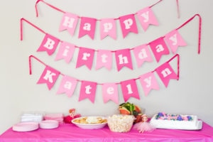 ballerina birthday party banner and food table