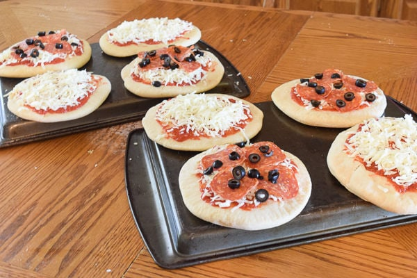 Homemade freezer pizzas ready to be flash frozen.