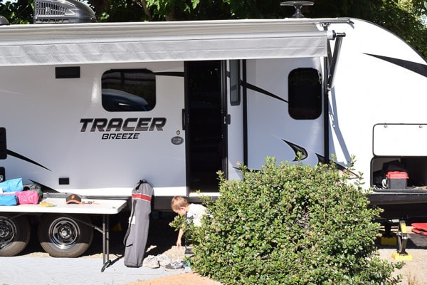 white travel trailer with door open