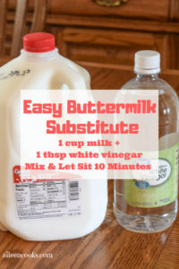 Gallon of whole milk and bottle of distilled white vinegar with text listing it as an easy buttermilk substitute