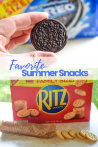 "Close up of an oreo cookie over a box of ritz crackers. Text in the center says ""favorite summer snacks""."