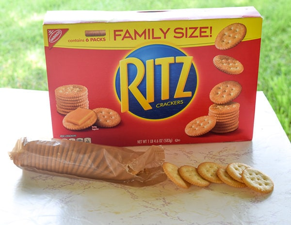 Box of ritz crackers with open sleeve or crackers in front.