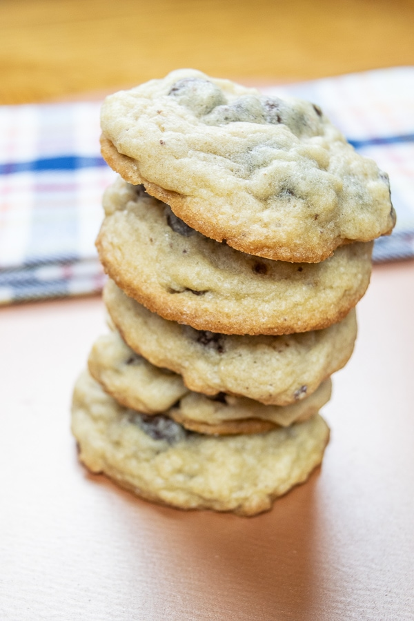 A stack of 5 salted chocolate chip cookies.