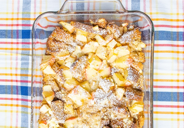 Apple-cinnamon french toast bake over a plaid tablecloth.