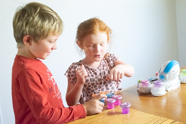 A brother and sister working together to play with the best musical toy for preschoolers - the think and learn rocktopus.