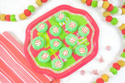 A plate full of green and red Christmas cookies.