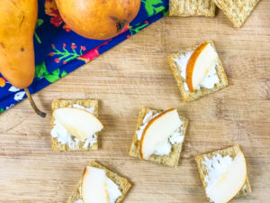 Goat cheese appetizers topped with sliced Asian pears.