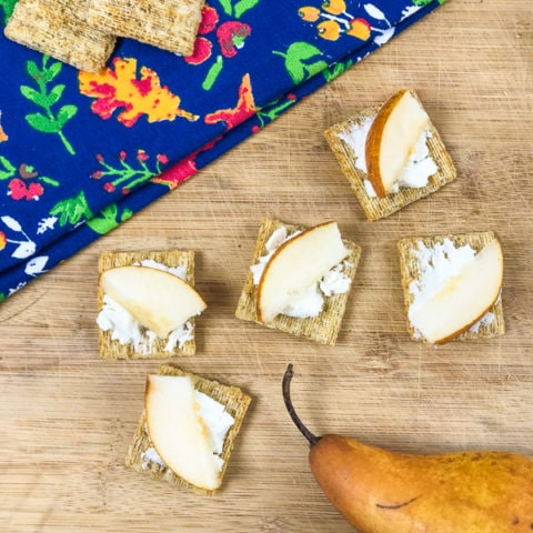 Triscuits topped with goat cheese and sliced pears.
