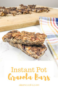 Instant pot granola bars stacked up next to a plaid towel.