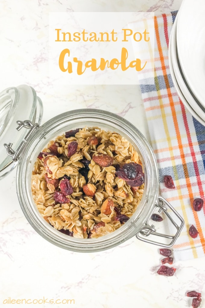 A jar full of instant pot granola with some spilling out onto the counter.