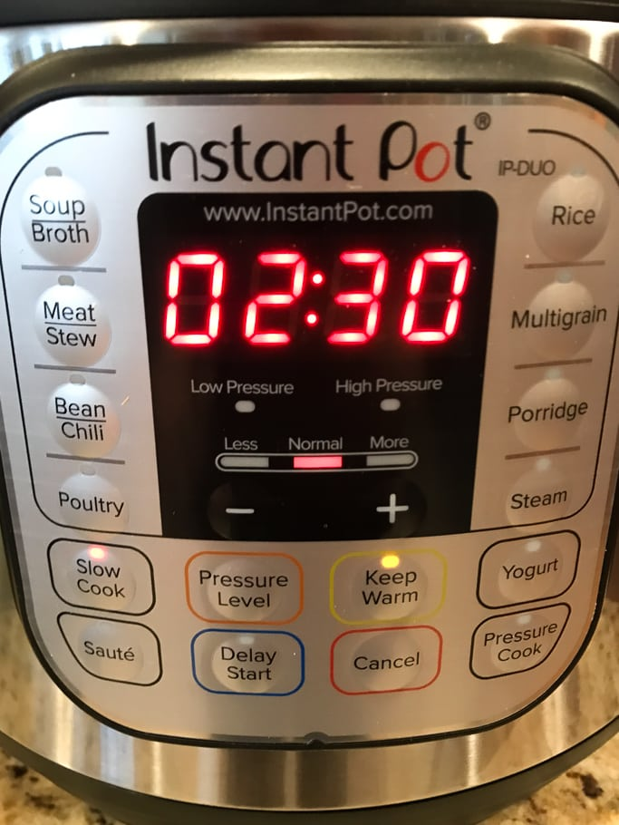 The front of an Instant Pot with the timer set to 2 hours 30 minutes.
