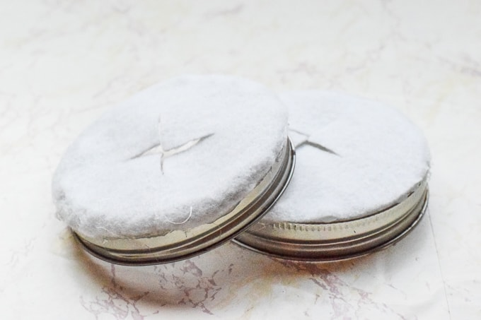 White felt hot glued to the ring of mason jar lids.