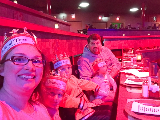 A family seated at Medieval Times.