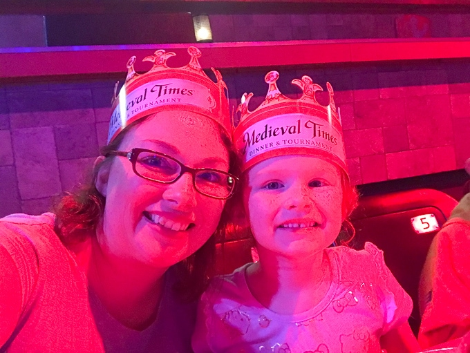 A woman and child wearing crowns at Medieval Times Buena Park.