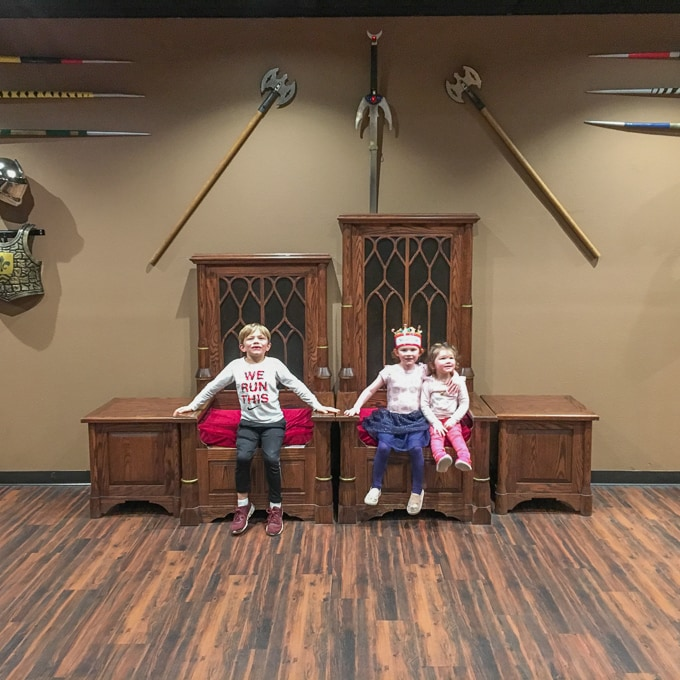 Three kids sitting on thrones at Medieval Times in Buena Park.