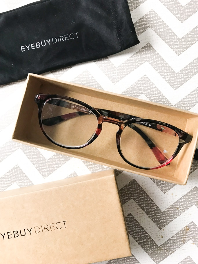 A pair of new glasses in a. box from EyeBuyDirect.