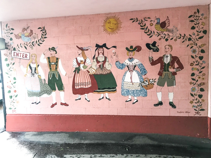 A colorful mural painted in the front driveway of Hofsas House.