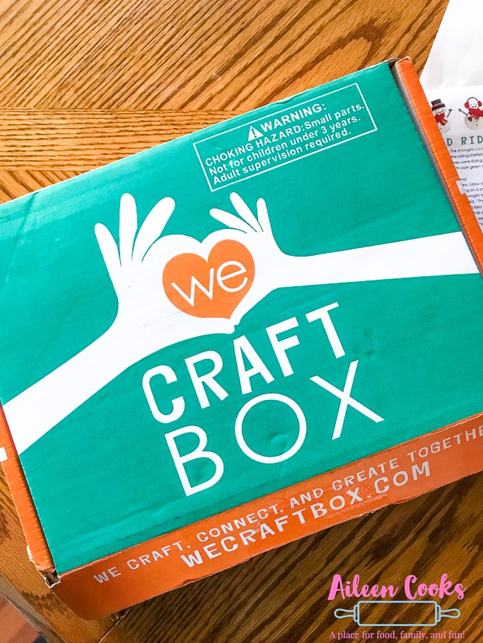 Teal and orange box with the words We Craft Box written on it.