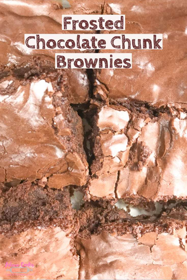 "A close up photo of chocolate chunk brownies with the words ""frosted chocolate chunk brownies""."
