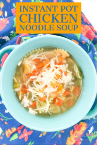 Chicken noodle soup made in the instant pot with fresh carrots and celery and frozen chicken breast. It all cooks in the same pot and is ready in under an hour.