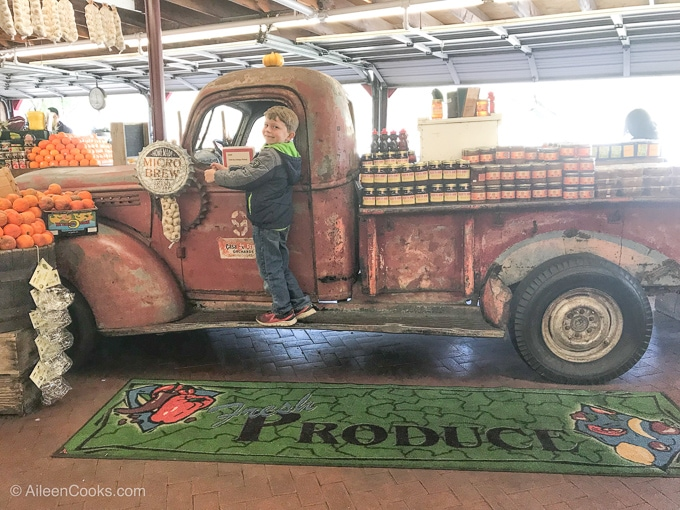 A boy on the truck inside Casa de Fruta fruit stand.