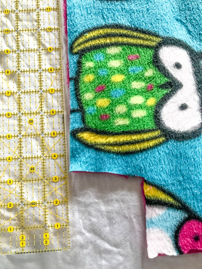 Owl fleece fabric next to a ruler.