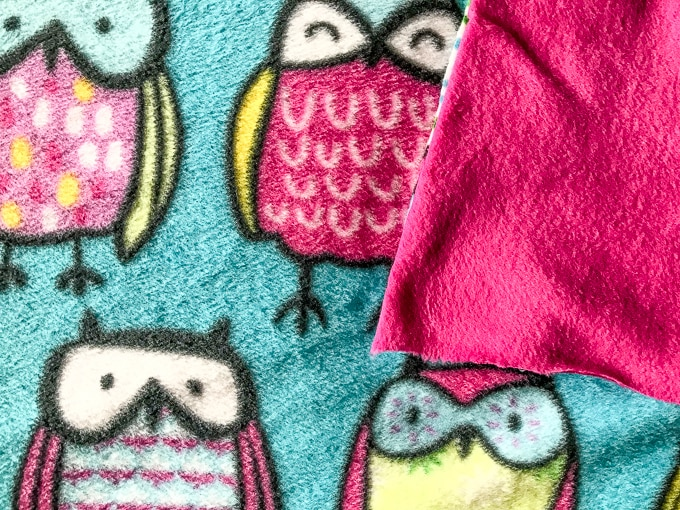 Owl fleece fabric with coordinating pink fleece fabric on top.