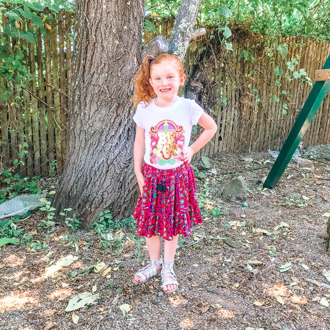 Little girl modeling a shirt and skirt from her Kidpik summer box.