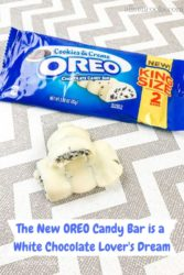 Oreo cookies and creme candy bar wrapper next to bar broken in half.