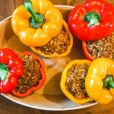 4 instant pot taco stuffed peppers in a serving dish.