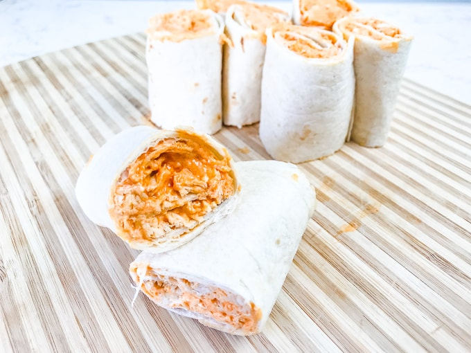 Two buffalo chicken roll ups stacked sideways on each other.