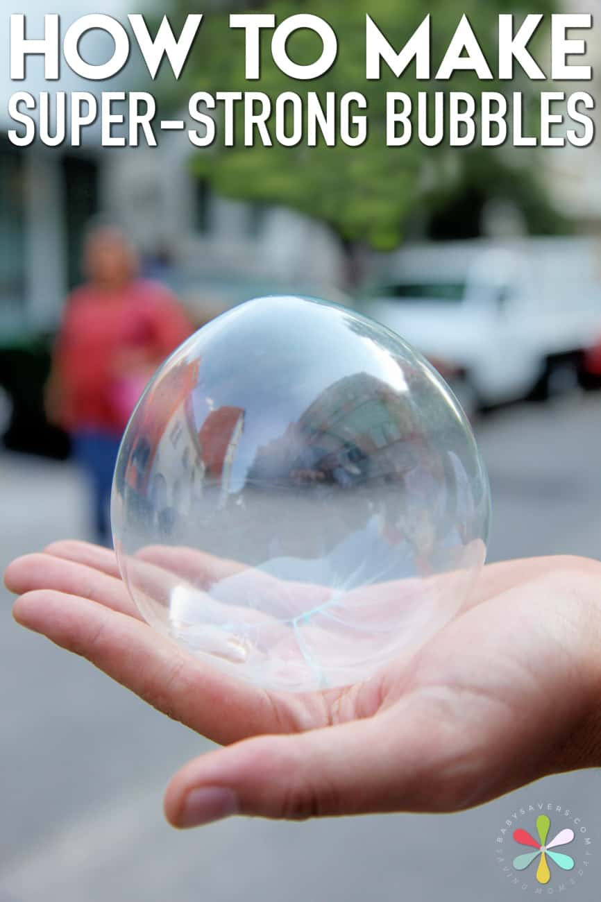 A hand holding a bubble.