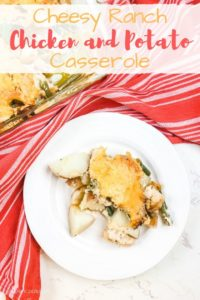 """A serving of chicken and potato casserole with the words """"cheesy ranch chicken and potato casserole"""" in red and gold."""