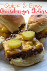 Three cheeseburger sliders on a white plate. One with the top of the bun off, showing the pickle toppings.