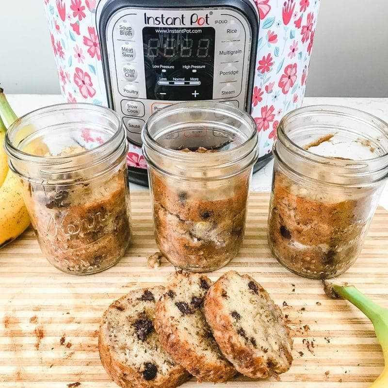 A round loaf of instant pot banana bread cut into three slices.