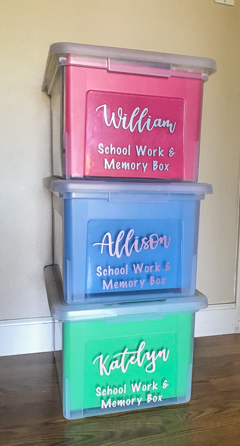Three school memory boxes stacked up against a wall.