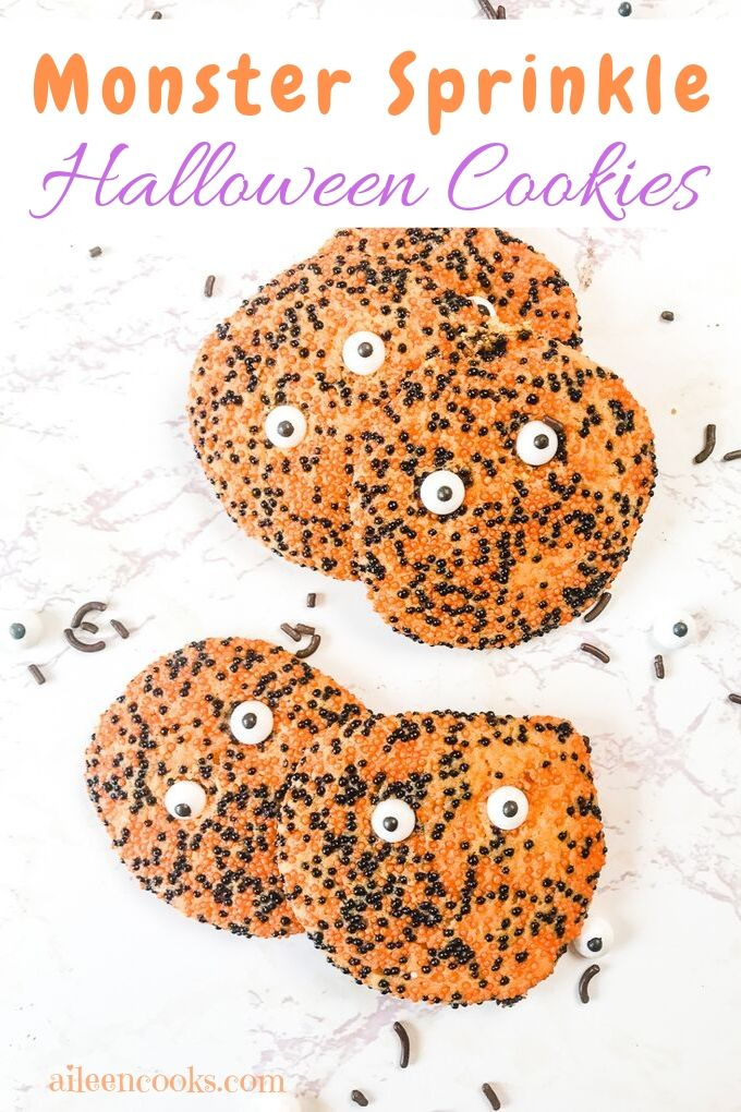 Halloween cookies covered in orange and black sprinkles.